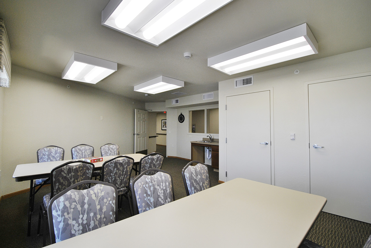 Multi-purpose room with tables and chairs at Grandhaven Manor