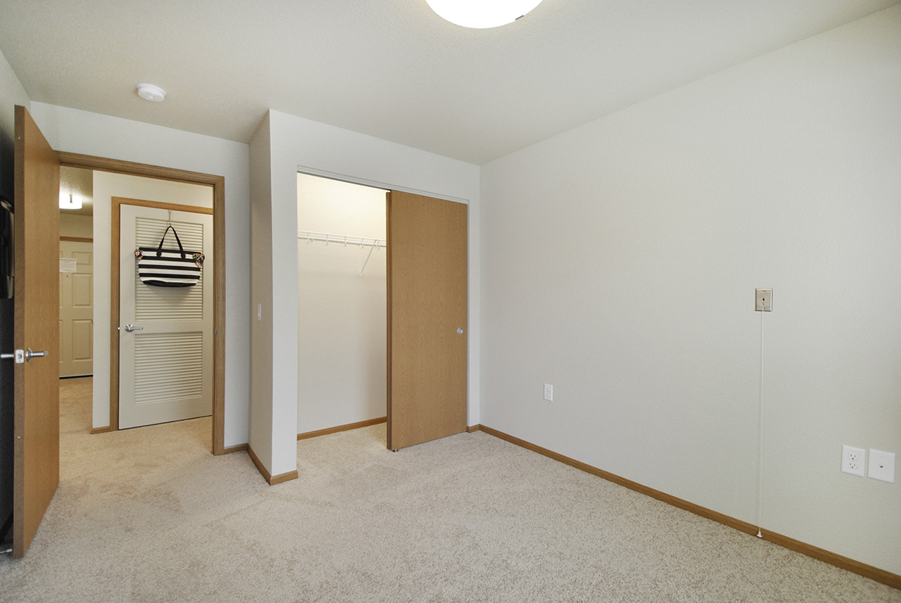 Living space interior with closet at Grandhaven Manor