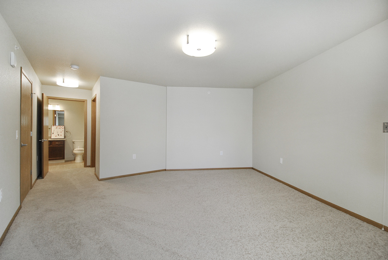 Large empty living space in Grandhaven Manor apartment