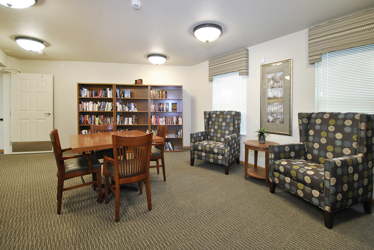 Seating area in study at Grandhaven Manor apartments