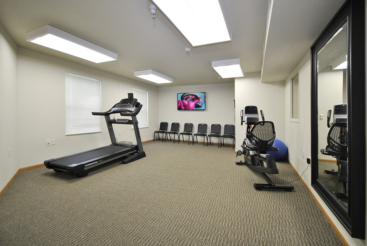 Fitness center at Grandhaven Manor apartments
