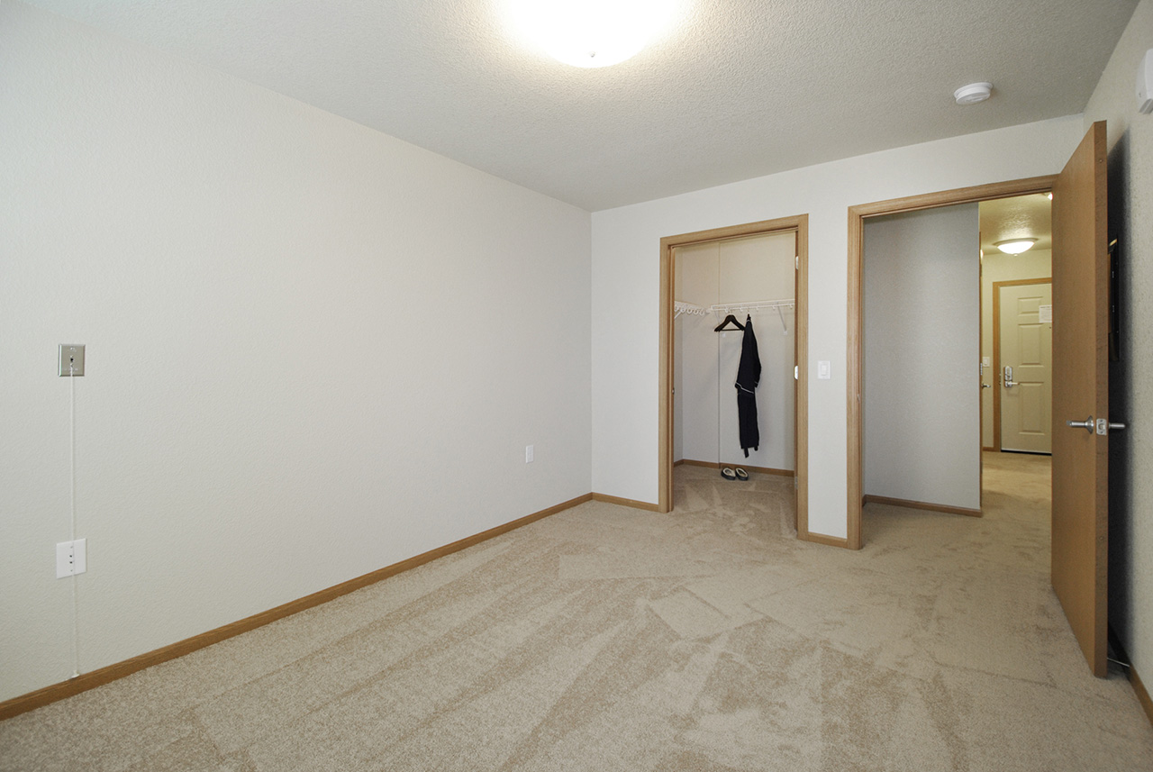Empty room of Grandhaven Manor apartment with closet