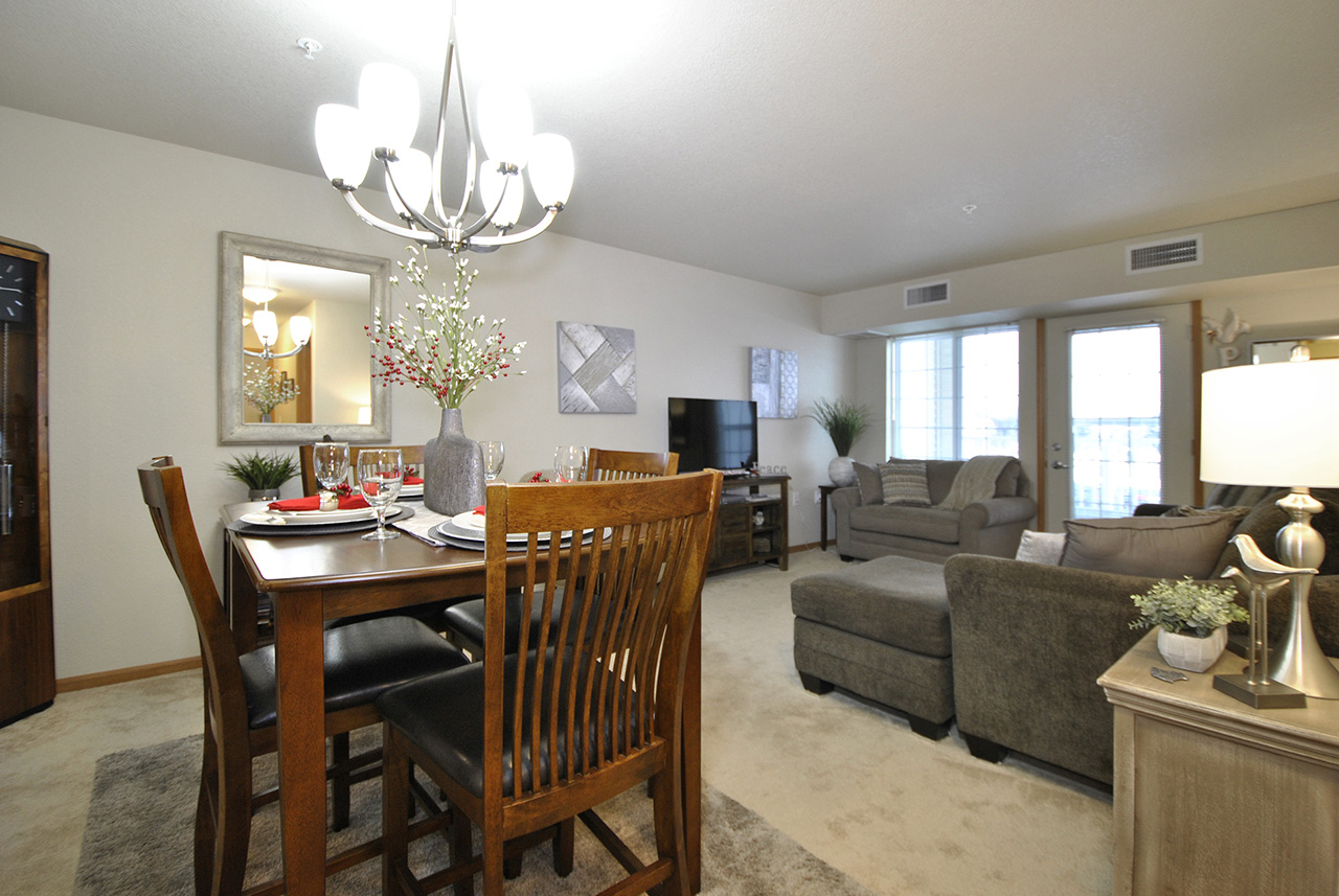 Living and dinning space of furnished Grandhaven Manor apartment