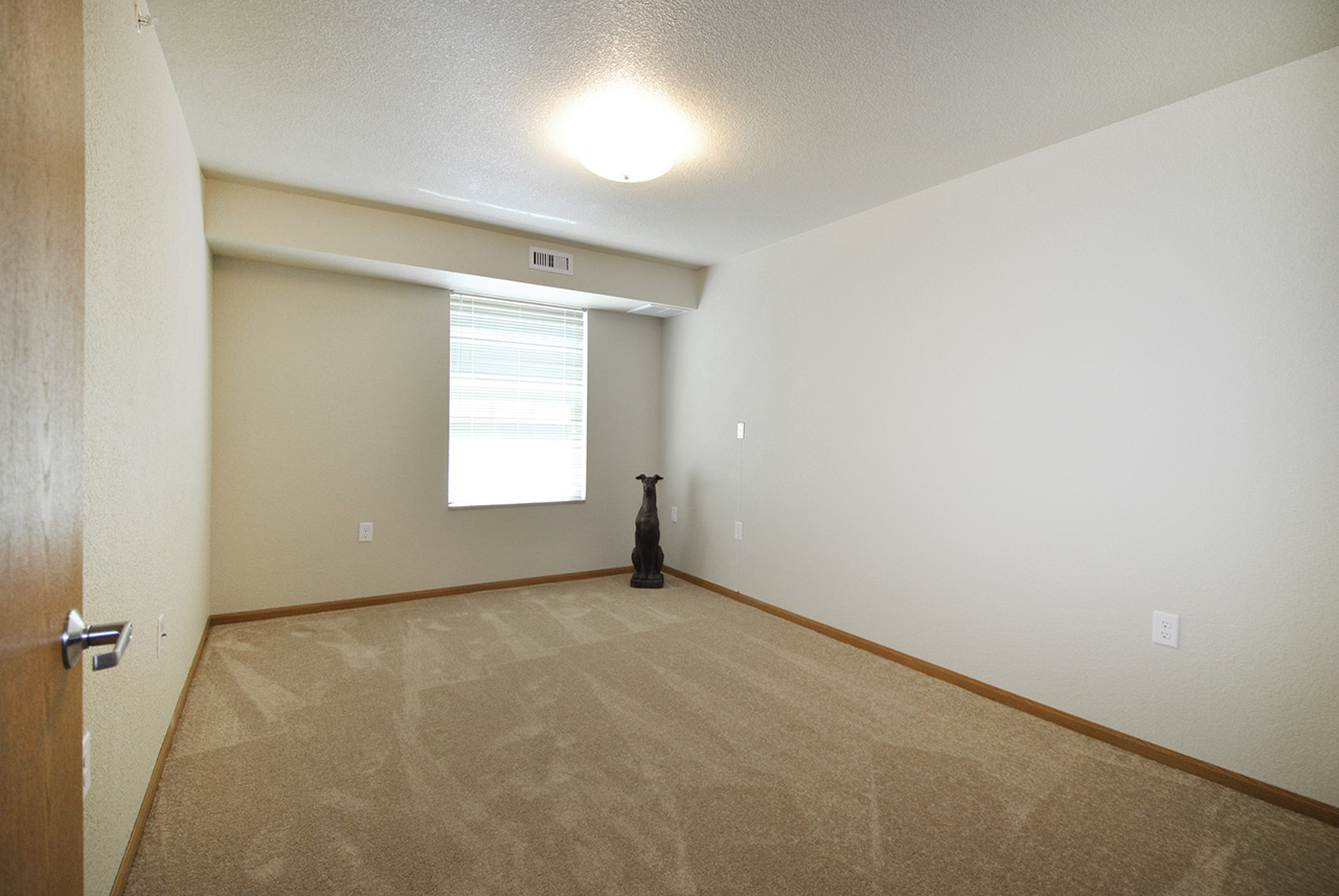 Empty room in Grandhaven Manor apartment with window