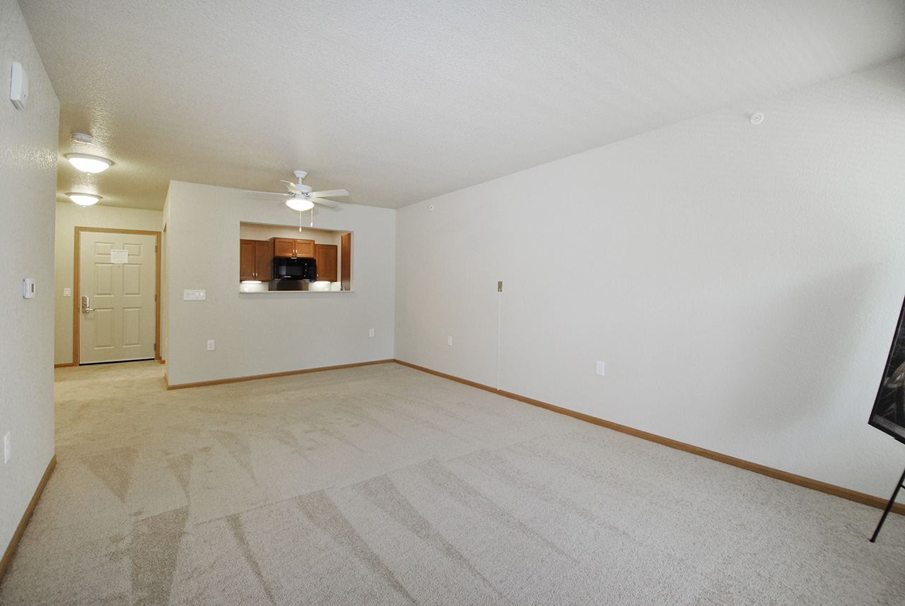 Empty living space with kitchen at Grandhaven Manor