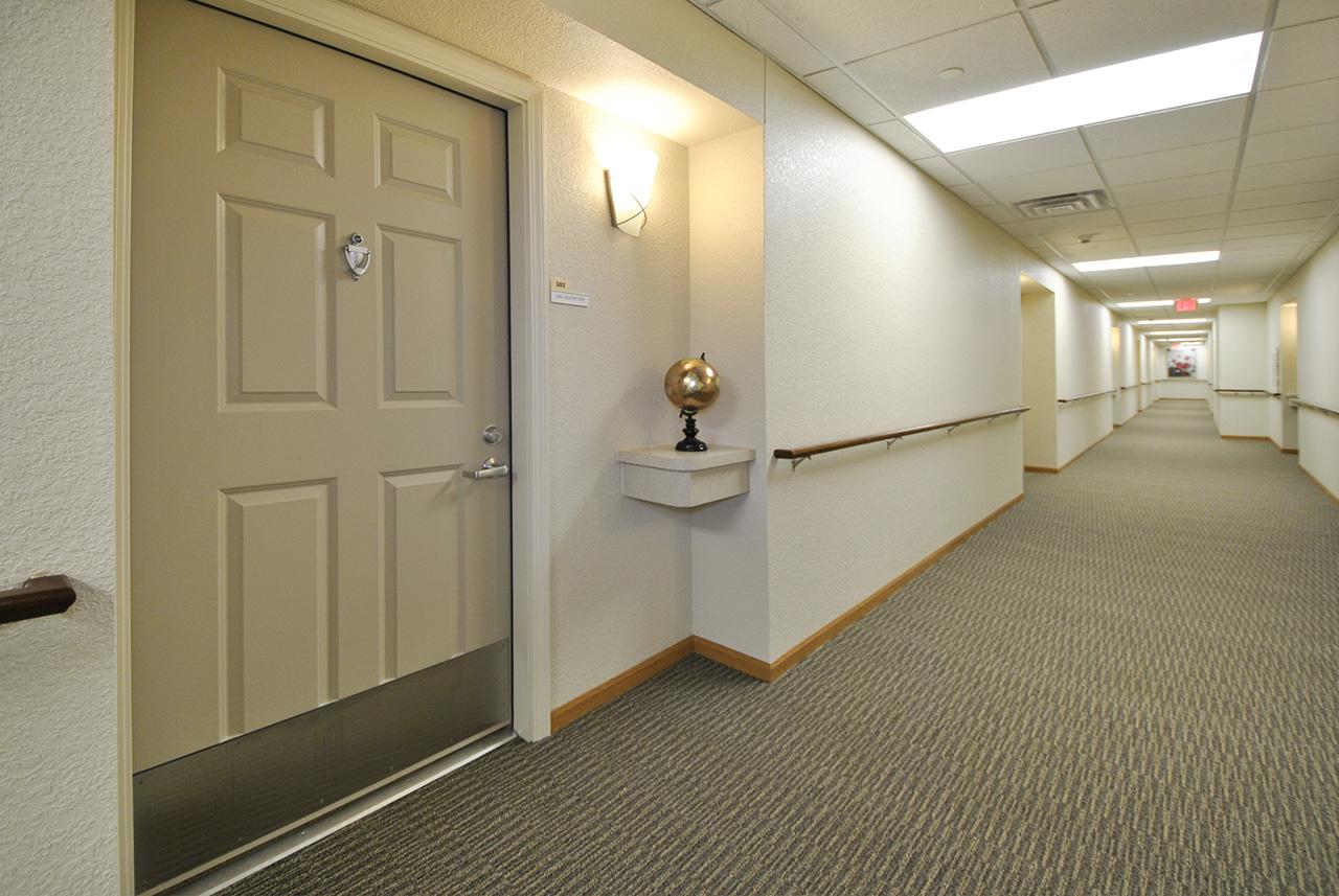 Hallway and door at Grandhaven Manor