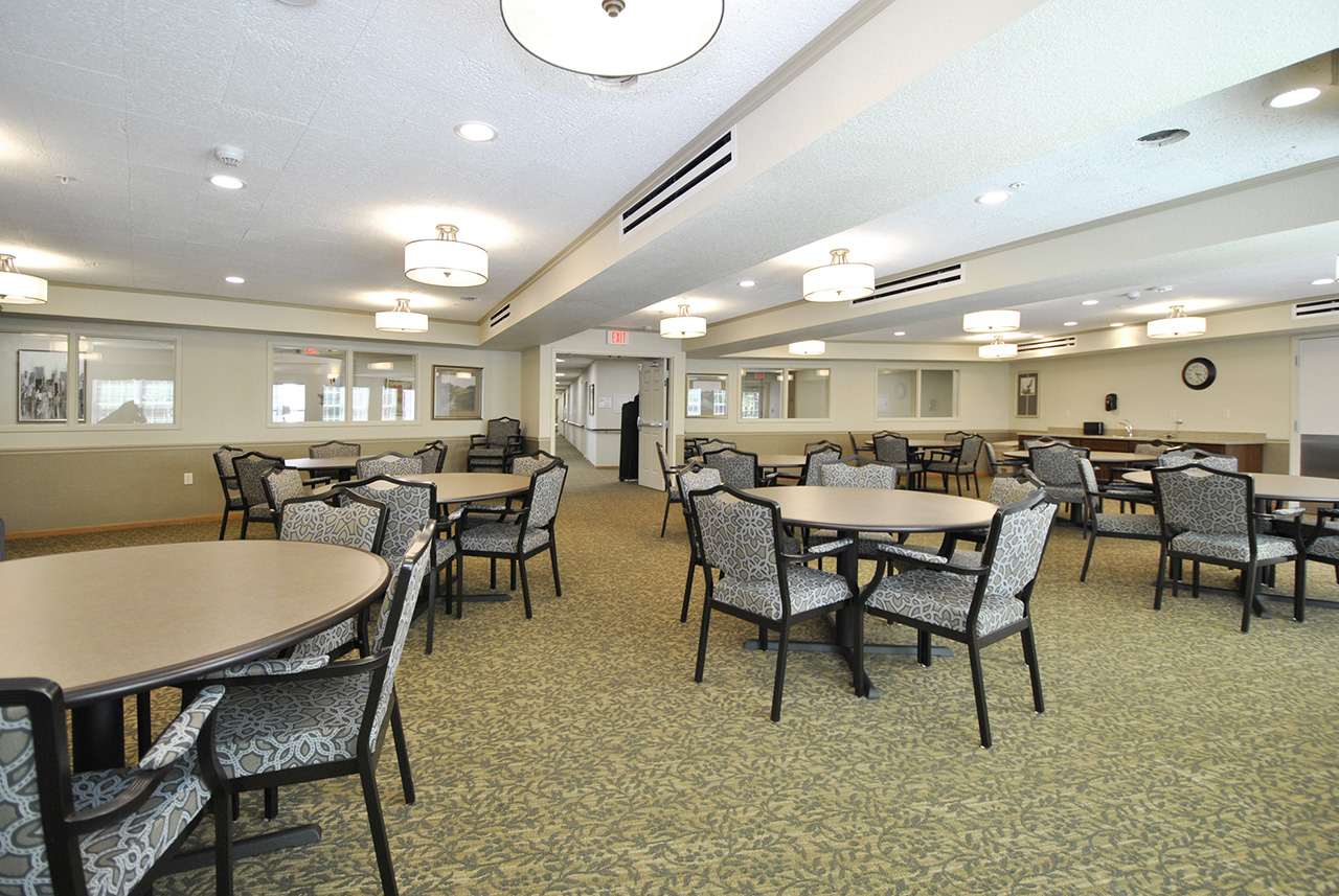 Dining room with tables and chairs at Grandhaven Manor