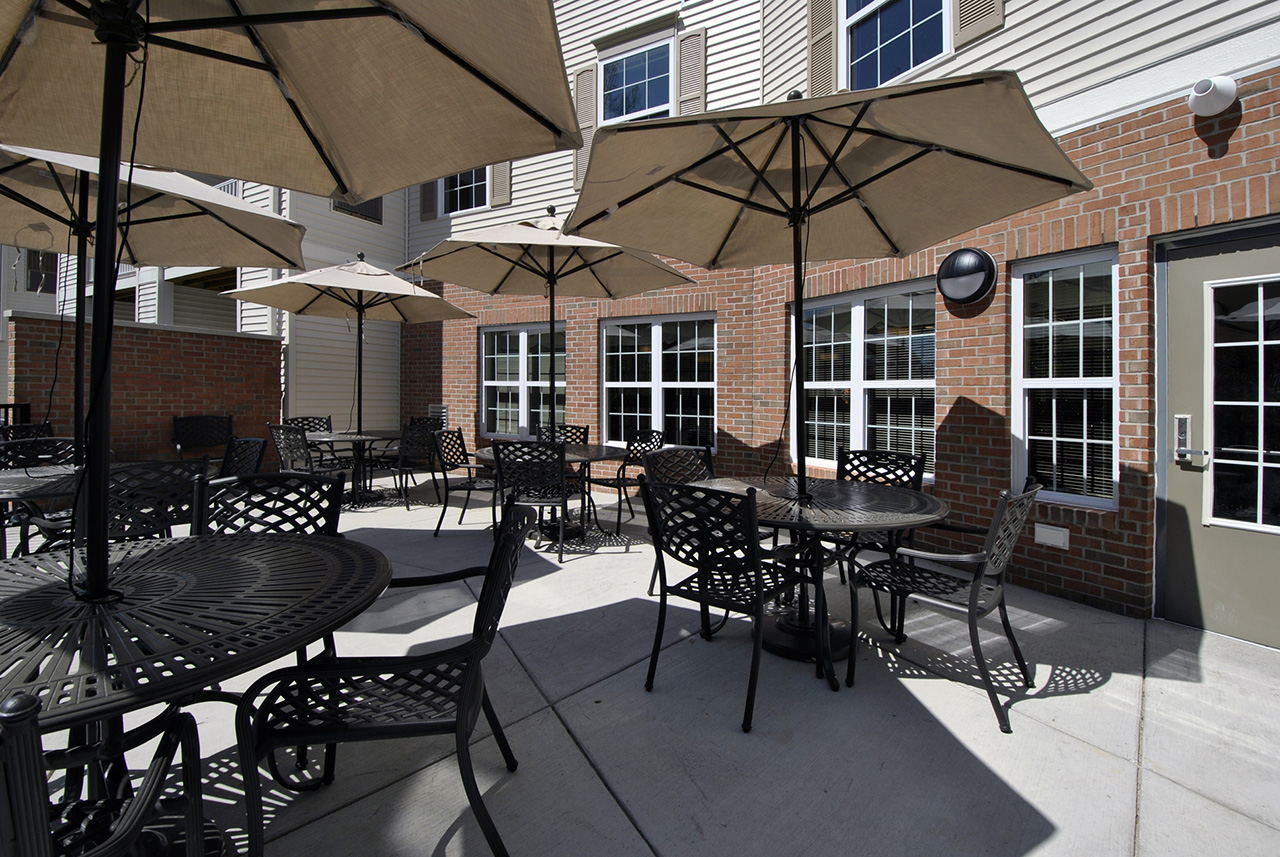 Outdoor seating tables at Grandhaven Manor