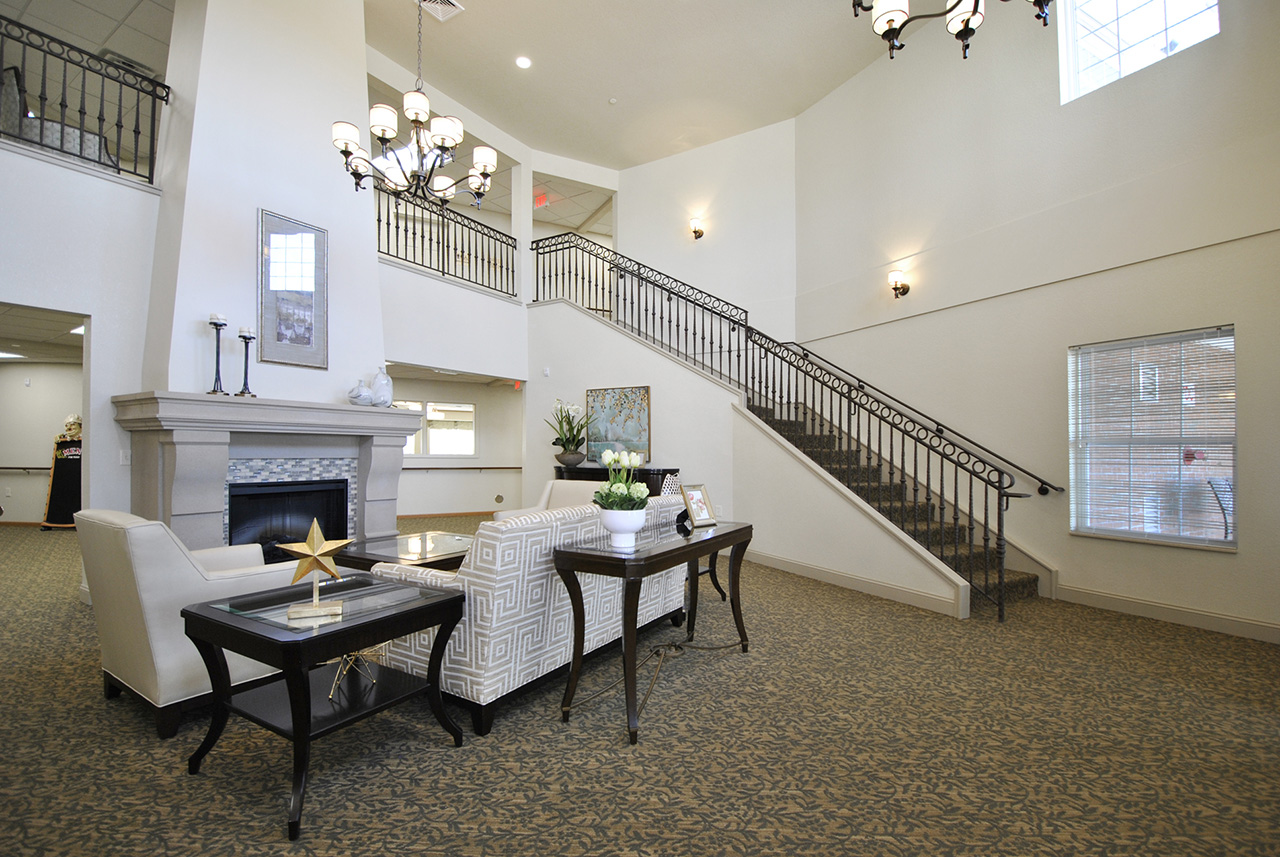 Entrance seating area and staircase at Grandhaven Manor